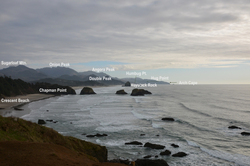 Scenic view southeast from second viewpoint east of Ecola Point. Sugarloaf Mountain, Onion Peak, and Angora Peak are thick submarine pillow breccias. Chapman Point headland and sea stacks are an invasive sill. Haystack Rock, the distant large sea stack, is submarine re-erupted pillow lavas and breccias. Humbug Point and Arch Cape are invasive dikes. (The Geological Society of America Field Guide 15, The Columbia River Basalt Group-From the gorge to the sea, 2009.)
